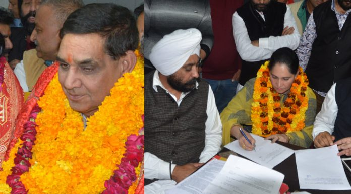 BJP candidates Chander Mohan Gupta and Purnima Sharma (Left) filing nomination papers for post of Mayor and Deputy Mayor respectively while Congress candidate (Right) Charanjeet Kour Shingari filling nomination papers for post of Deputy Mayor at Jammu on Saturday. —Excelsior/Rakesh