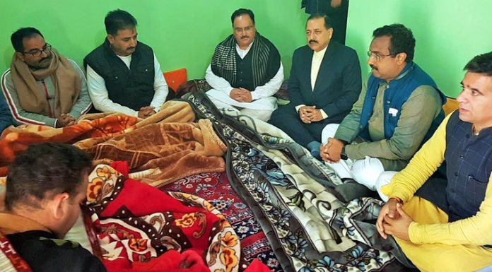 Union Ministers JP Nadda and Dr Jitendra Singh, along with BJP National General Secretary Ram Madhav and others during their visit to the family of late Anil Parihar and his brother, at Kishtwar on Tuesday.
