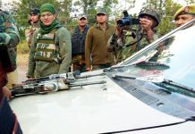 Army jawans pose with weapons recovered from militants and Tavera car they were travelling at Mendhar on Wednesday. —Excelsior/Rahi Kapoor