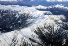 An aerial view shows Pir Panchal range covered with snow after season's first snowfall. —Excelsior/Shakeel