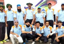Players of Vishal Cricket Club posing for group photograph after winning the match against Star Eleven in the ongoing 7th Eid Diwali Milan Cricket Cup at Parade ground, Jammu on Sunday.