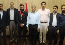 Medal winner Surya Bhanu Partap Singh and National Chief Coach (Wushu) Kuldeep Handoo of J&K Police posing for group photograph with ADGP Armed and Senior officers of APHQ during felicitation ceremony at APHQ Jammu.