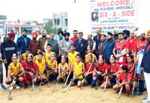 Players of MBS Simbal Camp and Young Khalsa Club posing for group photograph with dignitaries before their match.