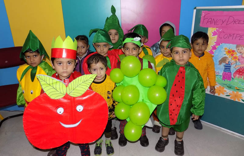 Kids attired in colourful dresses during a Children's Day function in Jammu.