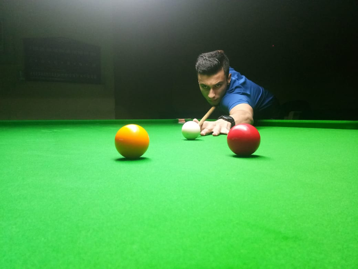 Cueist Aman Choudhary in action during match at Billiards Hall, MA Stadium Jammu on Tuesday. — Excelsior/Rakesh