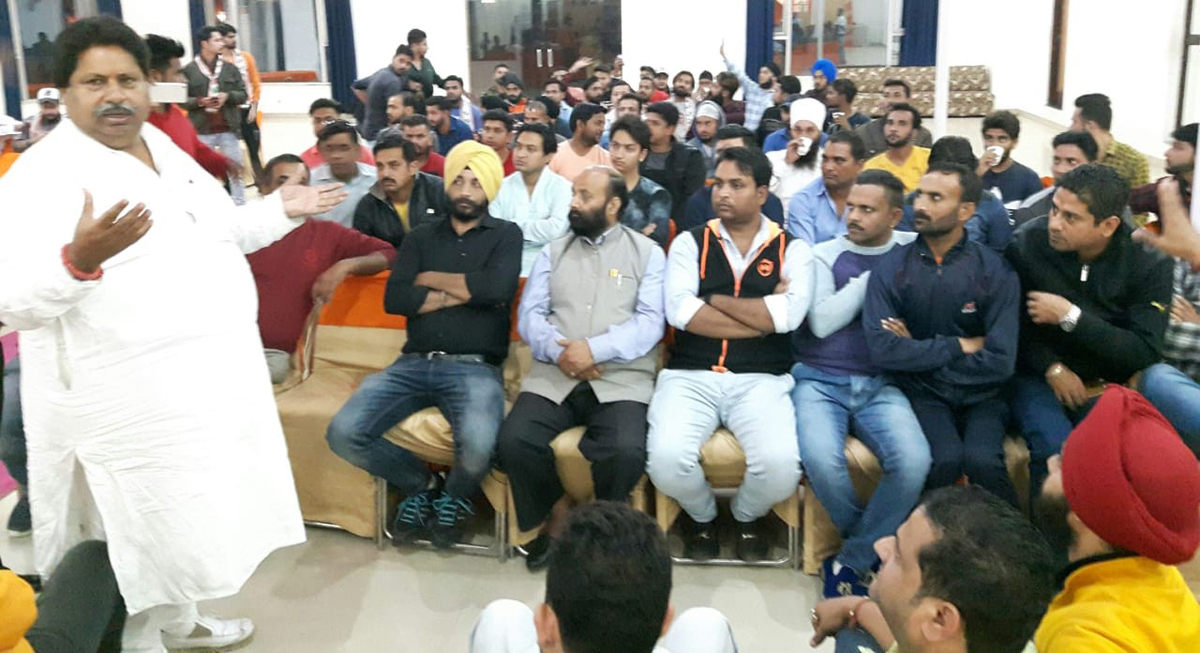 Senior Congress leader Raman Bhalla addressing gathering in Gandhi Nagar on Tuesday.