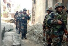 Security forces conducting searches in a locality of Rajouri on Thursday. — Excelsior/Amit Sharma