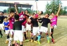 Players of Football Club Hiranagar in jubilant mood after winning final match.
