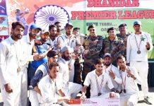 Dignitaries presenting trophy of Dhanidar Premier Cricket League to the winner team at DPL Rajouri on Sunday.