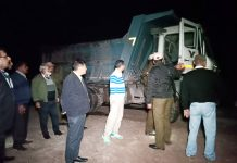 DC Kathua, Rohit Khajuria along with team seizing loaded tipper at the bank of river Ujh in Nagri area of Kathua on Friday night. -Excelsior/ Pardeep