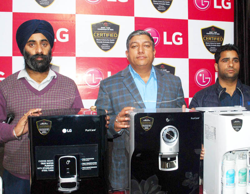 LG representatives launching Puricare range of Water Purifiers at Jammu on Friday. -Excelsior/Rakesh