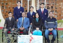 Team of APS students which emerged as runners up in National level Quiz, posing with Principal of the School, Sanjeev Kumar and other teachers.
