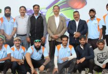 Players and dignitaries posing for group photograph.
