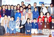 Winners of State Level Painting Competition posing for group photograph at Jammu.