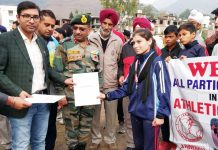 DC Poonch, Rahul Yadavalong with Commander of 93 Brigade presenting certificate to a winner of an Athletic Championship.