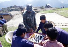Students during a chess competition organized by Army in Reasi district.