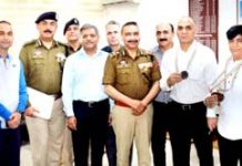 Police Badminton players posing for photograph with DGP Dilbag Singh and others.
