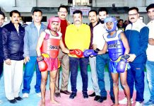 Zorawar Singh Jamwal, Secretary General Press Club Jammu inaugurating a bout to declare open State Level Wushu Championship.