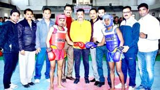 Zorawar Singh Jamwal, Secretary General Press Club Jammu inaugurating a bout to declare open State Level Wushu Championship.
