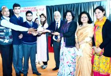 Dignitaries awarding the winner team of Inter School Mega Quiz.