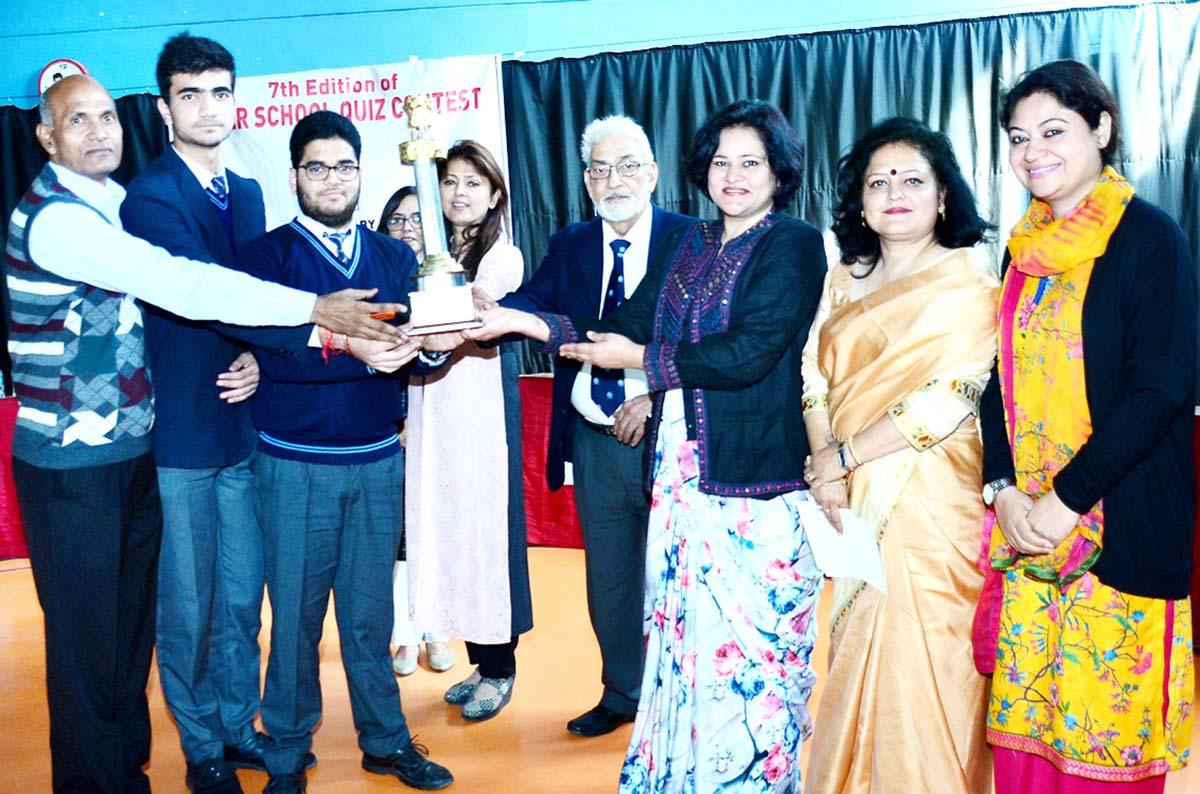 Dignitaries awarding the winner team of Inter School Mega Quiz.
