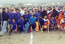 Winning Hockey team posing with coaches and other dignitaries.