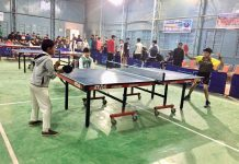 Boys in action during a Table Tennis match at Badminton Hall in Udhampur.