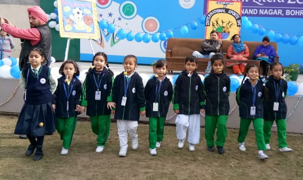 Students taking part in spoon race during Annual Sports Day function.