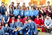 Winners of Inter-School Patriotic Singing Competition and dignitaries posing for group photograph.