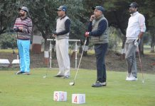 Golfers keenly watching during a game at BSF Paloura Camp in Jammu.