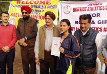Dignitaries awarding a winner of Jammu District Athletics Championship at Jammu on Wednesday.