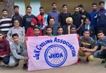 Selected cyclists posing for photograph alongwith officials of J&K State Sports Council and J&K State Cycling Association.
