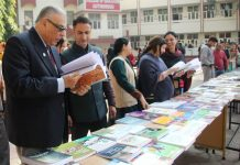 Dignitaries showing keen interest during book exhibition at MIER.