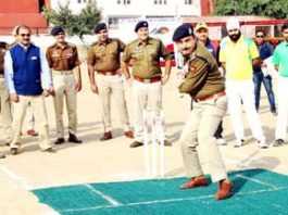 IGP Jammu Zone Dr SD Singh Jamwal hitting a ball to inaugurate 7th Eid-Diwali Milan Cricket Cup at Jammu on Saturday.