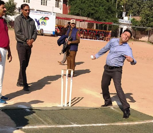Divisional Commissioner Sanjeev Verma testing his bowling skills in a match organized during ongoing 7th Eid-Diwali Milan Cricket Cup at Parade Ground Jammu on Tuesday.