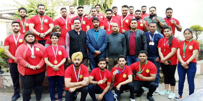 Power Lifting players and officials of J&K State Sports Council and Power Lifting Association posing for group photograph.
