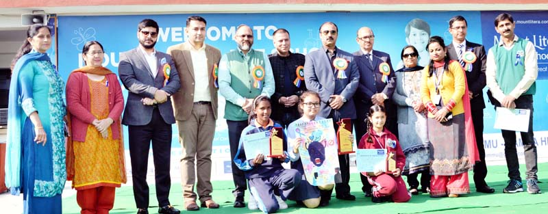 Winners and dignitaries posing for group photograph.