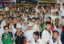 Medals winners of J&K Inter-School Taekwondo Championship posing for group photograph.