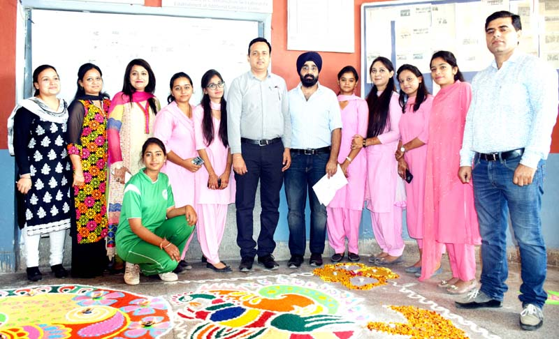 Winners of Rangoli Competition and dignitaries posing for group photograph.