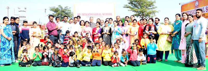 Medal winners and dignitaries posing for group photograph.