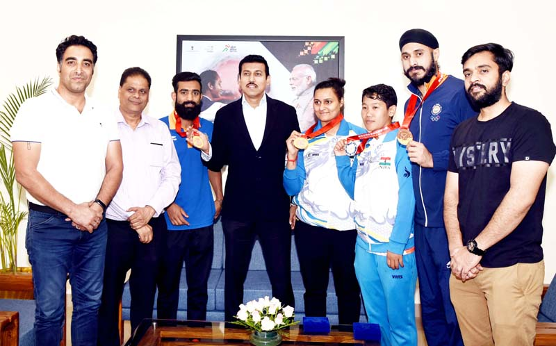 Union Sports Minister along with Indian Wushu team posing for group photograph.