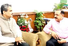 Union Minister Dr Jitendra Singh being briefed by the newly appointed Chairman of National Highway Authority of India (NHAI) Sanjeev Ranjan, at New Delhi on Monday
