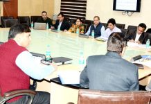Advisor to Governor Kewal Krishan Sharma chairing a meeting on Monday.