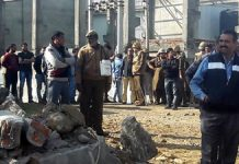 Officers of district administration Samba and Police during an anti-encroachment drive in industrial area Bari-Brahmana on Thursday.
