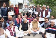NC MLA from Nagrota Devender Singh Rana protesting along with KPs against murder of Dileep Langer at Jammu on Sunday.