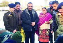 DGP Dilbag Singh and others seeing off injured DySP and his family at airport.