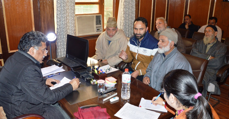 Advisor Khurshid Ahmed Ganai interacting with a delegation on Sunday.