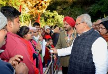 Governor Satya Pal Malik interacting with pilgrims during his visit to Shri Mata Vaishno Devi Shrine on Friday.