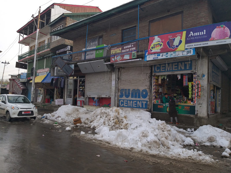 Snow blocks the entrance of shops at main market Shopian in South Kashmir. — Excelsior/Younis Khaliq