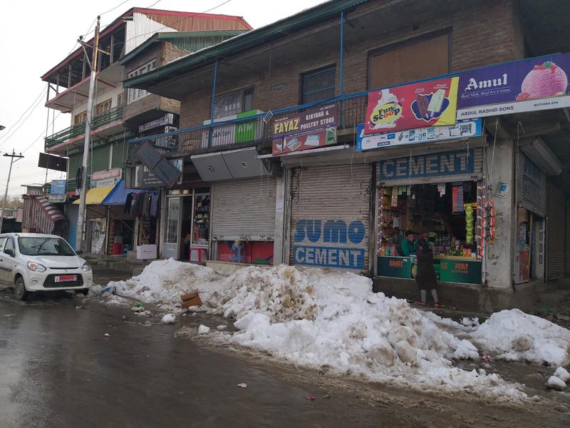 Snow blocks the entrance of shops at main market Shopian in South Kashmir. — Excelsior/Younis Khaliq